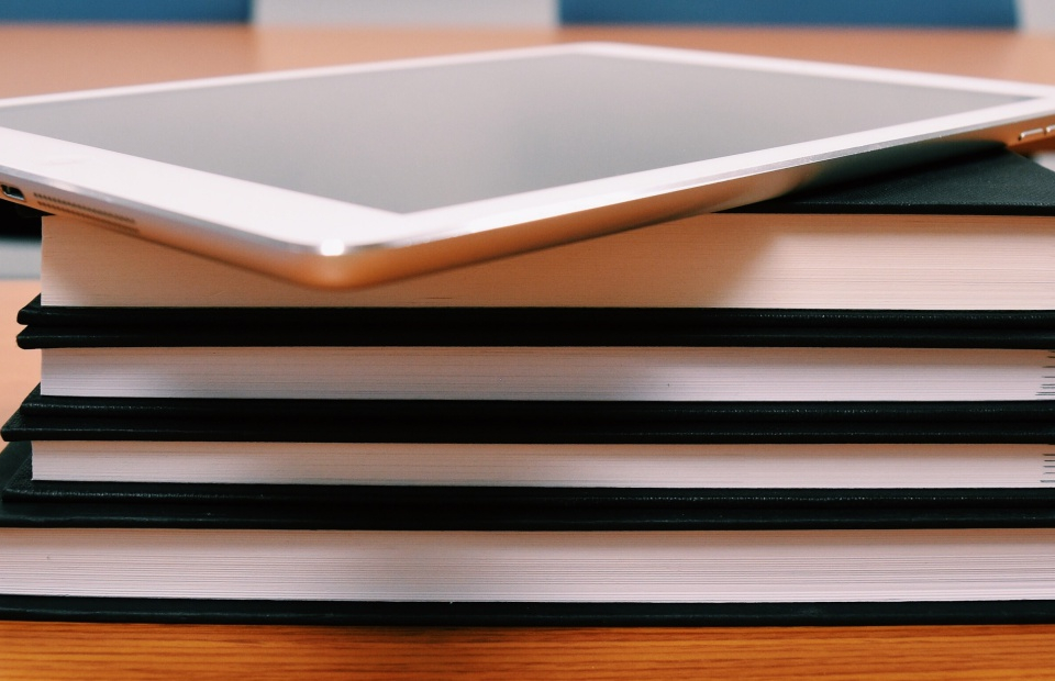 tablet on books